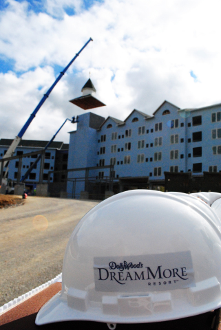 Crews complete the outside profile of Dollywood's DreamMore Resort during a topping out ceremony on Oct. 22, 2014. (Photo: Business Wire)