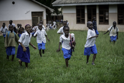 Students of SOS Children's Village Bangui run out of school at the end of classes (Photo: Business W ...