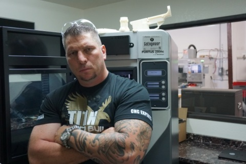 "Titan Gilroy next to the Stratasys Fortus 250mc 3D Printer, which will be featured in the first episode of ""TITAN American Built."" (Photo: Business Wire)"