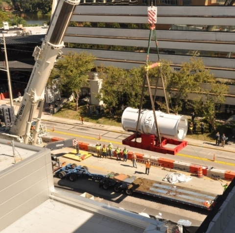 The MEVION S250 accelerator, being lifted by a crane as it is delivered to the UF Health Cancer Center - Orlando Health (Photo: Business Wire)