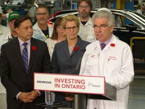 Honda of Canada Mfg. (HCM), a division of Honda Canada Inc., announced that it will invest $857 million over three years to innovate its three award-winning manufacturing plants in Alliston, ON with new technologies and processes.  Left to right, Ontario Minister of Economic Development, Employment and Infrastructure, Brad Duguid; Premier of Ontario, Kathleen Wynne; and President and CEO of Honda Canada Inc., Jerry Chenkin. (Photo: Business Wire)