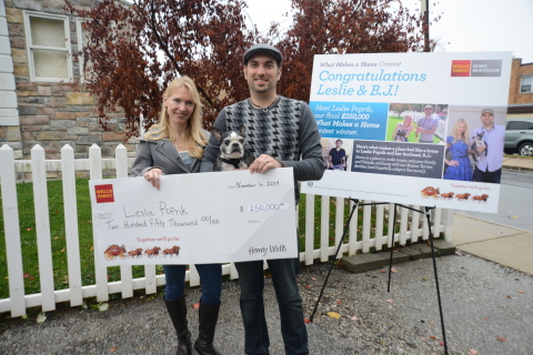 """Leslie Poprik of Ardmore, Pennsylvania is the third and final winner of Wells Fargo's """"What Makes a Home"""" contest. Wells Fargo presented Leslie and her husband, B.J. Capelli, with the $250,000 prize on Nov. 6, 2014. Also pictured is their Boston terrier Berklee, who plays a role in the music video that Leslie and B.J. created as their contest entry. (Photo: Business Wire)"""