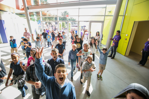 Students from local schools in the San Fernando Valley celebrate being the first visitors to Discovery Cube Los Angeles seconds after its official dedication in the Lake View Terrace neighborhood. For a limited time, admission is just $10. (Photo: Business Wire)