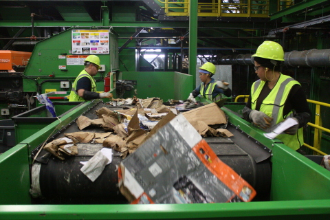 Conveyor belt at a single-stream recycling facility, where recyclables are separated by both machines and workers. (Photo: Business Wire)
