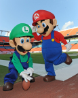 In this photo provided by Nintendo of America, Mario and Luigi take the field at Sun Life Stadium before the face-off between Florida State and University of Miami on Nov. 15, 2014. The two video game icons were in town to show football fans Super Smash Bros. for Nintendo 3DS and the forthcoming Super Smash Bros. for Wii U. Nintendo of America is bringing these all-star brawling games to college campuses across the country this fall as a part of the College Tailgate Tour.