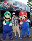 In this photo provided by Nintendo of America, Mario and Luigi visit Florida State University and University of Miami fans to showcase Super Smash Bros. for Wii U outside Sun Life Stadium in Miami, Florida. The latest installment of the Super Smash Bros. franchise, which lets players compete against friends by choosing from an extensive lineup of iconic video game characters, will debut on the Wii U system on Nov. 21, 2014.