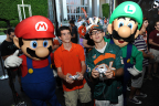 In this photo provided by Nintendo of America, Mario and Luigi cheer on a heated Super Smash Bros. for Wii U battle outside the University of Miami vs. Florida State University football game on Nov. 15, 2014. The Super Smash Bros. for Wii U game, launching on Nov. 21, 2014, is the first fighting game in the series to allow eight local players to play simultaneously.