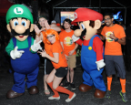 In this photo provided by Nintendo of America, excited football fans gather outside Sun Life Stadium before the Florida State University vs. University of Miami game on Nov. 15, 2014, for the chance to play the Super Smash Bros. for Nintendo 3DS and Super Smash Bros. for Wii U game. Nintendo of America is bringing these all-star brawling games to college campuses across the country this fall as a part of the College Tailgate Tour.