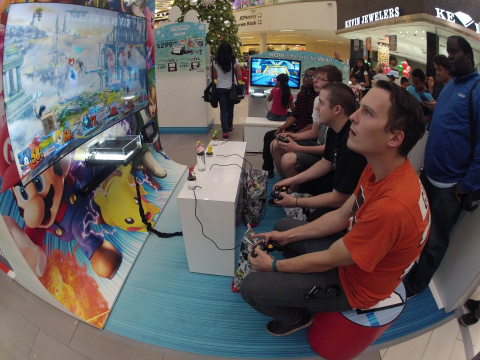 In this photo provided by Nintendo of America, Jacob O., 24, of Philadelphia (R), competes against other consumers playing Super Smash Bros. for Wii U at the Westfield Culver City mall in Los Angeles on Nov. 24, 2014. Until Dec. 21, 2014 in 16 malls nationwide, many of Nintendo's games will be playable in fun, interactive spaces that kids – and kids-at-heart – will love, including large high-definition displays that will host a Mario Kart 8 and Super Smash Bros. for Wii U. Visitors can also check out the recently released Pokémon Omega Ruby and Pokémon Alpha Sapphire as well as amiibo, Nintendo's new toys-to-life figures based on its favorite video game characters including Mario, Donkey Kong and Pikachu. (Photo by Nintendo/Bob Riha, Jr.)