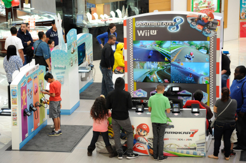 """In this photo provided by Nintendo of America, kids play some of Nintendo's hottest video games on Wii U and Nintendo 3DS/2DS during the company's """"Holiday Mall Experience"""" inside the Westfield Culver City mall in Los Angeles on Nov. 24, 2014. The free experience is open until Dec. 21, 2014 in 16 major cities nationwide and showcases must-have holiday games such as Super Smash Bros. for Wii U, Mario Kart 8, Pokémon Omega Ruby, Pokémon Alpha Sapphire and Captain Toad: Treasure Tracker among others. (Photo by Nintendo/Bob Riha, Jr.)"""