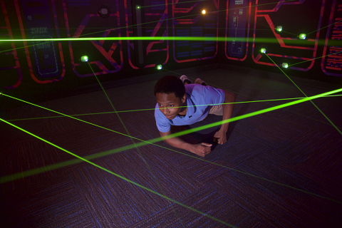 Guests use their ninja stealth skills to navigate a web of high-tech lasers during the interactive experience. (Photo: Business Wire)