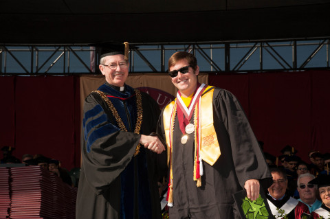 SCU President Michael Engh, S.J. and the Santa Clara University community congratulate alum Aven Satre Meloy '13 on his Rhodes Scholarship. (2013 Graduation pictured here.) (Photo: Business Wire)