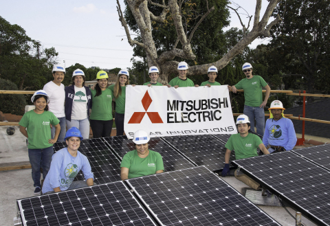 Employee volunteers from Mitsubishi Electric's Cypress, California headquarters and students from California State University Long Beach's Disabled Student Services donated their time last week to install a solar electric system on the roof of a Long Beach home. (Photo: Business Wire)
