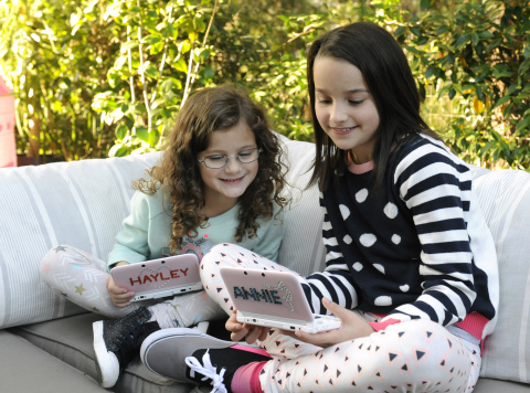 In this photo provided by Nintendo of America and released November 24, 2014, YouTube sensations and sisters Annie and Hayley Bratayley play Tomodachi Life on Nintendo 3DS XL while filming a promotion for the game, November 12, 2014 in Los Angeles. In the Tomodachi Life game, available exclusively for the Nintendo 3DS family of systems, players can make Mii characters of their friends and family members and see what exciting things happen. Players will watch their Mii characters' lives unfold in silly, spontaneous and hilariously dramatic ways. (Photo by Nintendo/Bob Riha, Jr.)