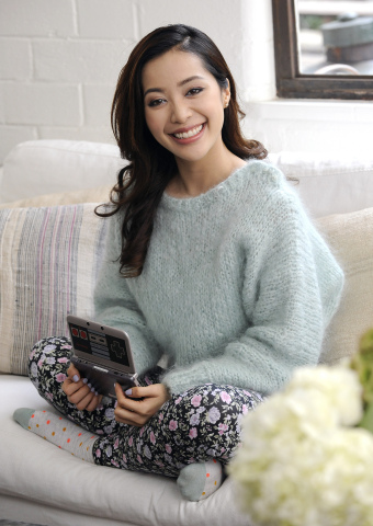 In this photo provided by Nintendo of America and released November 24, 2014, makeup artist and YouTube star Michelle Phan takes a break while filming a promotion for Animal Crossing: New Leaf – a video game exclusively available on the Nintendo 3DS family of systems, November 11, 2014 in Los Angeles. In the game, players act as mayors of their own towns and can customize different aspects of the game (such as their personal appearances and homes), interact with the animal residents and visit a tropical island. (Photo by Nintendo/Bob Riha, Jr.)