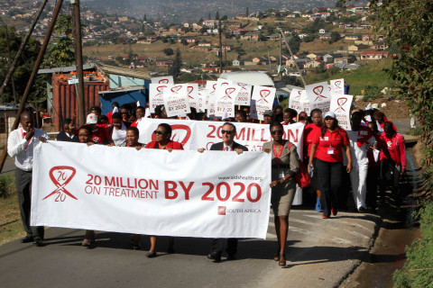 Representatives from the AIDS Healthcare Foundation (AHF) and the KwaZulu-Natal Department of Health march with local residents in Durban, South to celebrate the groundbreaking of the first AHF clinic in South Africa to be built from the ground up in Umlazi. For World AIDS Day, AHF will host over 160 events around the world to promote testing, treatment for HIV AIDS. Holding banner: (2nd from right): Michael Weinstein, AIDS Healthcare Foundation President; (Far right): Penninah Iutung Amor, MD, AHF Africa Bureau Chief. (Photo: Business Wire)