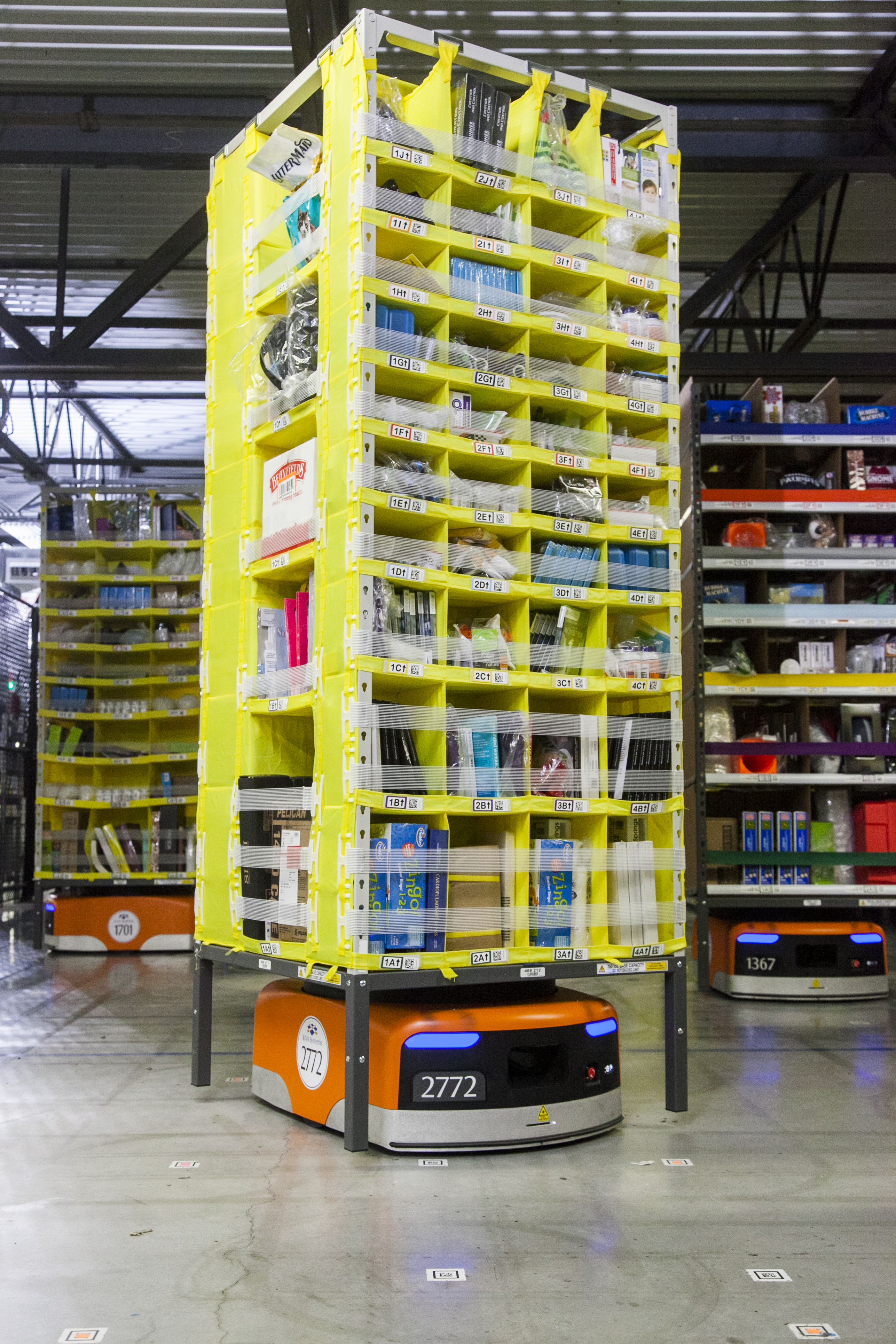 A Kiva robot moves product in Amazon's eighth generation fulfillment center. (Photo: Business Wire)