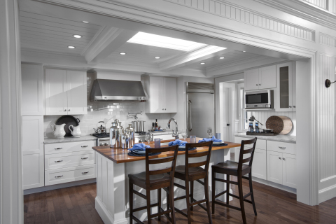 The HGTV Dream Home kitchen is warm and inviting with pro-grade appliances and rich textures that draw in the blue hues from the great room. The countertops are fashioned from Carrara marble while mahogany slabs provide plenty of serving space on the island and bar. (Photo: Business Wire)