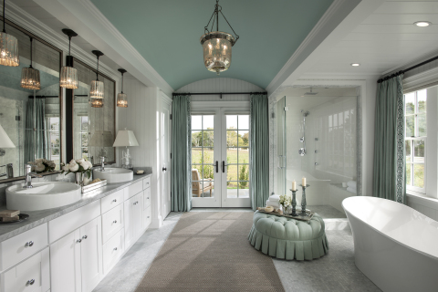 The HGTV Dream Home master bathroom is a tranquil retreat with ample space for relaxing. The room features a stunning white vanity with dual basins, a sculptural tub, walk-in shower, and French doors leading out to a private patio. (Photo: Business Wire)