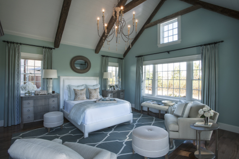 The HGTV Dream Home master bedroom is the beautiful focal point of the private master suite that includes a huge bath, dressing room and walk-in closet. The watery blue theme provides a serene setting complete with stone fireplace and seating area. (Photo: Business Wire)