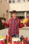 Nolan Gould Poses with Toys at Old Spice's HoliSPRAY Toy Donation Exchange (Photo: Business Wire)