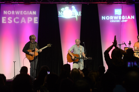 Norwegian Cruise Line and Jimmy Buffett's Margaritaville announce partnership to bring first location to sea on the all-new Norwegian Escape, coming Fall 2015. Jimmy Buffet surprises Norwegian employees at company event with announcement of new partnership and an impromptu performance on December 4. (Photo: Business Wire)