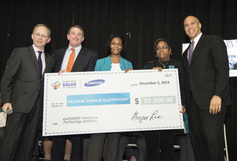 Samsung Executive Vice President Dr. David Steel, accompanied by U.S. Senator Cory Booker and Newark Public Schools Assistant Superintendent Dr. Peter Turnamian, presented Peshine Avenue Elementary School leaders with a $50,000 technology grant (Photo: Business Wire)