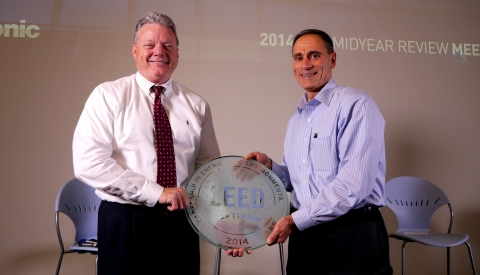 Panasonic Corporation of North America CFO Mike Riccio (photo right), who led the company's effort to secure LEED certification, presents the LEED Platinum plaque to company Chairman & CEO Joseph M. Taylor (left). The plaque will be installed in the building lobby to remind employees and visitors of Panasonic's aim to maintain the highest eco standards. (Photo: Business Wire)