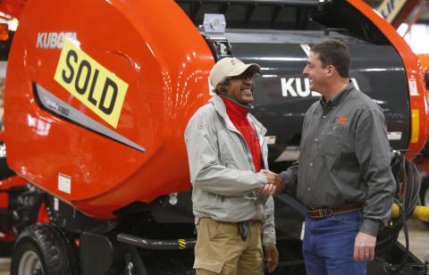 Customer Frank Westbrook (left) shakes hands with Kubota Dealer John Scott of Kubota Center West Tulsa as he proudly takes ownership of his new BV4180 Hay Baler. (Photo: Business Wire)