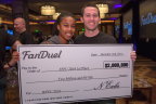 2014 FanDuel Fantasy Football Champion Scott Hanson and his wife receive grand prize check for $2 Million. (Photo: Business Wire)