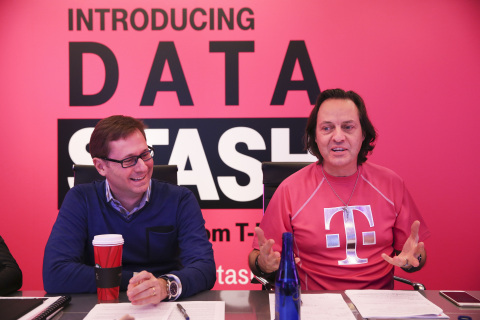T-Mobile executives John Legere, right, and Mike Sievert, left, host a media briefing announcing Un-