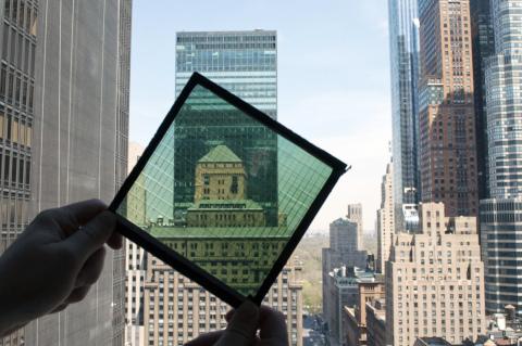 New York City skyscrapers as seen through high-performance SolarWindow™ module. (Photo: New Energy Technologies, Inc.)