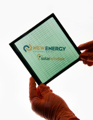 High-performance SolarWindow™ module in neutral green-blue tint. (Photo: New Energy Technologies, Inc.)