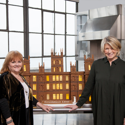 "Actress Lesley Nicol, who plays Downton Abbey's ""Mrs. Patmore,"" stopped by Martha Stewart's New York City test kitchen to see Martha's ""Gingerbread Abbey"" created in honor of the upcoming season 5 premiere on PBS Masterpiece. Martha, whose highly rated cooking shows Martha Bakes and Cooking School also air on PBS, is a huge fan of the show so was thrilled to meet Mrs. Patmore in person and show her around her kitchen. (Photo: Business Wire)"