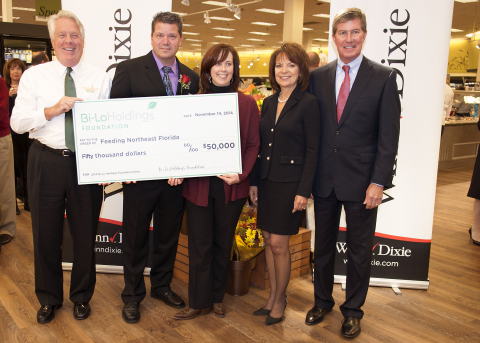 Pictured above: (left to right) Feeding Northeast Florida President and CEO Bruce Ganger, Winn-Dixie Store No. 5 Director Greg Vengrin, Bi-Lo Holdings Foundation President and CMO Mary Kellmanson, Bi-Lo Holdings Foundation Board Member Pamela Onstead and Bi-Lo Holdings President and CEO Randall Onstead present a foundation grant to the food bank to fight food insecurity. (Photo: Business Wire)