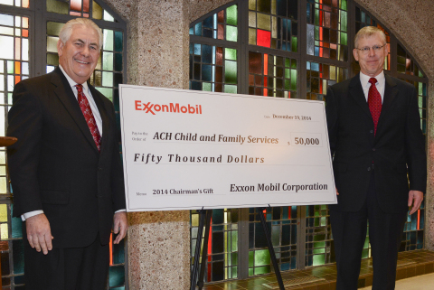 Rex W. Tillerson, chairman and chief executive officer, Exxon Mobil Corporation, presents the company's 2014 chairman's gift to Dr. Wayne Carson, chief executive officer, ACH Child and Family Services, kicking off the organization's 100th anniversary. (Photo: Business Wire)