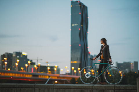 The FlyKly Smart Wheel replaces the rear wheel on an ordinary bike to transform it into a 21st century smart bike that offers the benefits of both electric and human-powered cycling. (Photo: Business Wire)