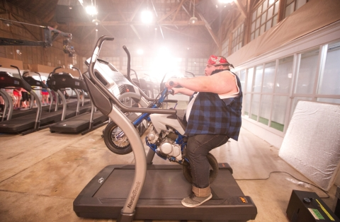 Christian Busath, star of many YouTube videos, rides a mini motorcycle on a NordicTrack Incline Trainer. See it at the iFit booth #74321 in the Sands Expo Center. (Photo: Business Wire)