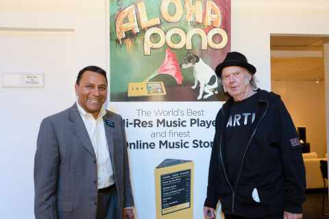 LAS VEGAS: Legendary recording artist Neil Young and HARMAN CEO Dinesh Paliwal discuss bringing the PonoMusic catalog and HD quality audio into vehicles during the Consumer Electronics Show 2015. By joining forces, HARMAN and Pono aim to deliver the best in audio to music lovers. (Photo: Business Wire)