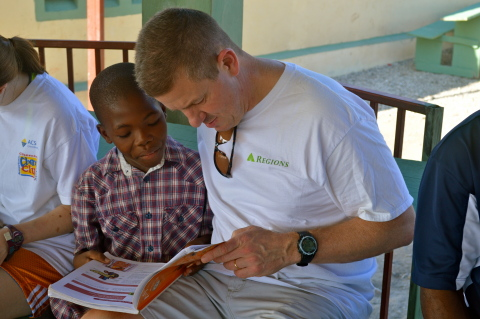 James Dusenberry reads with Jobenson Charles, a child who lives at the orphanage James' church founded in Williamson, Haiti. (Photo: Business Wire)