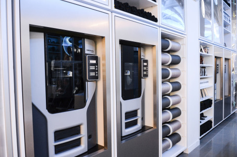 Ten Stratasys Fortus 250mc 3D Printers line the perimeter of Normal's store in New York City. (Photo ...