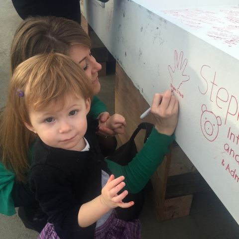 Rowan, born two years ago at Lucile Packard Children's Hospital Stanford, leaves her mark on the final steel beam of the hospital's expansion, January 14, 2015. (Photo: Business Wire)
