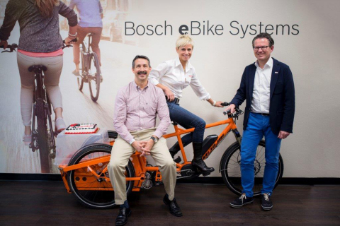 Bosch Leadership at new eBike headquarters - Bosch leadership (Tim Frasier, Claudia Wasko and Markus Schmidt, from left to right) on an electric tricycle at the company's new eBike headquarters in Irvine.(Photo: Business Wire)