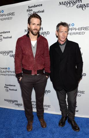 """Actors Ryan Reynolds and Ben Mendelsohn walk the """"Sapphire blue"""" carpet at the """"Mississippi Grind"""" premiere party hosted by Chase Sapphire Preferred during the Sundance Film Festival on Saturday, Jan. 24, 2015 in Park City, Utah. (Photo by Evan Agostini/Invision for Chase Sapphire Preferred/AP Images)"""