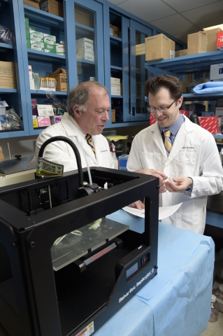 Daniel A. Grande, PhD, director of the Orthopedic Research Laboratory at the Feinstein Institute, and Todd Goldstein, an investigator at the Feinstein Institute, part of the North Shore-LIJ Health System, with their MakerBot Replicator Desktop 3D Printer that they used to 3D print cartilage to repair tracheal damage. (Photo: Business Wire)