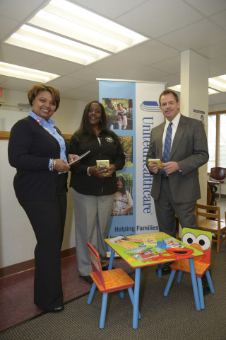 Athens Neighborhood Health Center East COO Cshanyse Allen and CEO Mellinda Craig, and UnitedHealthcare employee Michael Hathcock set up a new Sesame Street reading corner at the Athens Neighborhood Center East. This is one of 14 reading corners being donated as part of UnitedHealthcare's Healthy Habits for Life partnership with Sesame Workshop (Photo: Windgate Downs).