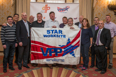 Denver Transit Partners' Aaron Epstein and Michael Lipinski (Fluor Corporation) as well as Fluor's Herb Morgan accept the OSHA VPP Star award Friday. (Photo: Business Wire)
