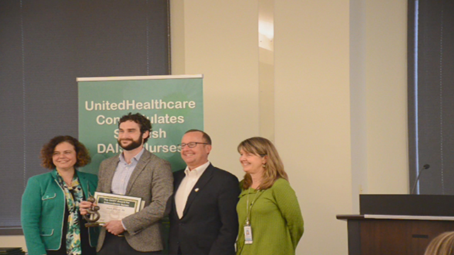 Melissa Barnes, vice president, The DAISY Foundation, and David Hansen, UnitedHealthcare's regional president of network management - West region, present The DAISY Award to Jessee Kilgren, RN, at a special ceremony today at Swedish Medical Center in Seattle (Video: Landen Zumwalt).