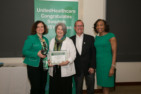 Melissa Barnes, vice president, The DAISY Foundation and David Hansen, UnitedHealthcare's regional president of network management - West region, present The DAISY Award to Deb Cadiente, RN, Swedish Medical Group at a special ceremony today at Swedish Medical Center in Seattle. Also pictured Charlotte Foster, nurse executive, Swedish Medical Group (Photo: Kim Doyel).