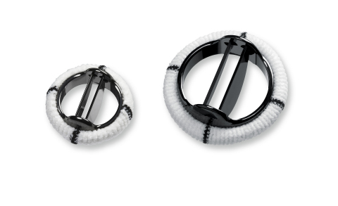 Image of the St. Jude Medical Masters HP Series 15mm mechanical heart valve pictured in comparison t